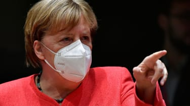 Angela Merkel pictured wearing a white face mask.