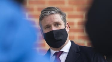 Keir Starmer visits a building wrapped in unsafe cladding.