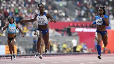 Britain's Dina Asher-Smith crosses the finish line to win the women's 200m final in Doha