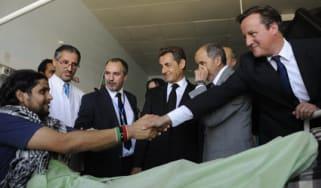 Nicolas Sarkozy and David Cameron in Tripoli
