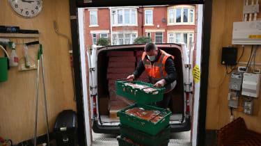 A volunteer is seen sorting food at Blackpool Food Bank
