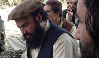 In this photograph taken on October 4, 2009 shows new Pakistani Taliban chief Hakimullah Mehsud (L) sits with his commander Wali-ur Rehman (R) during his meeting with local media representati