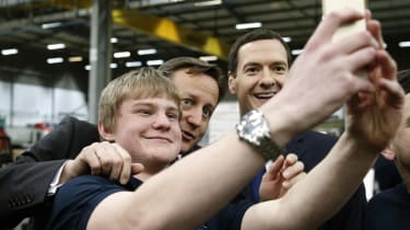 ILKLEY, ENGLAND - FEBRUARY 05:British Prime Minister David Cameron (2nd L) and Chancellor of the Exchequer George Osborne (R) pose for a selfie photograph with an apprentice during a visit to