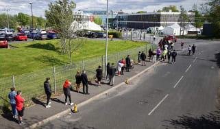 People queue for vaccinations during a spike in the India variant in Bolton