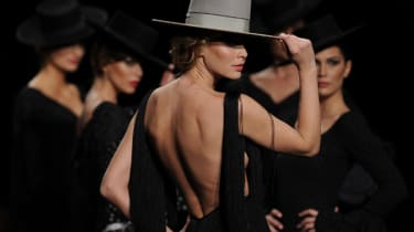 Models present creations by Rocio Peralta during the first day of the SIMOF (International Flamenco Fashion Show) in Sevilla, on February 5, 2015.AFP PHOTO/ CRISTINA QUICLER(Photo credit shou
