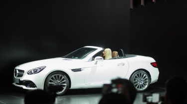 The 2016 Mercedes-Benz SLC is unveiled at the company's press conference at the 2016 North American International Auto Show in Detroit, Michigan, January11, 2016.AFP PHOTO / GEOFF ROBINS / AF