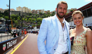 MONTE-CARLO, MONACO - MAY 24:England captain Chris Robshaw outshone by girlfriend Camilla Kerslake are seen outside the Infiniti Red Bull Racing team garage before the Monaco Formula One Gran