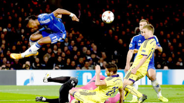 Chelsea's Didier Drogba hurdles over goalkeeper Jasmin Handanovic of Maribor