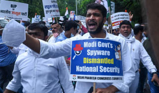 People in New Delhi demonstrating with placards