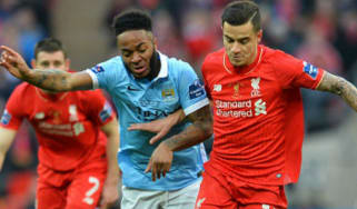 Raheem Sterling of Manchester City and Philippe Coutinho of Liverpool