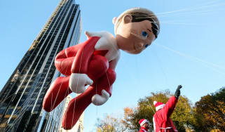 The Elf on the Shelf balloon floats in Columbus Circle during the 91st Annual Macy's Thanksgiving Day Parade on November 23,