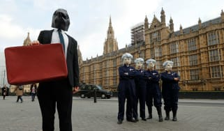Protesters dressed as Philip Hammond and Theresa May outside parliament ahead of last week's budget