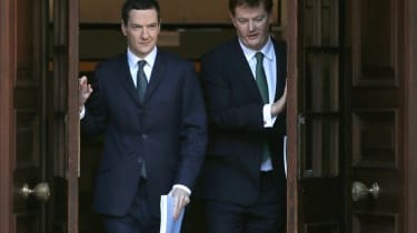 Britain's Finance Minister George Osborne (L) and the Chief Secretary to the Treasury Danny Alexander leave the Treasury for the House of Commons to deliver the Autumn statement in central Lo