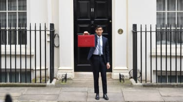 Chancellor Rishi Sunak poses with the Budget Box outside 11 Downing Street