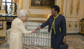 The Queen greets Governor-General of Barbados Dame Sandra Mason at Buckingham Palace