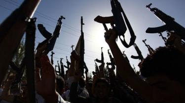Militants brandish their weapons in Iraq