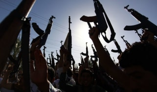 Militants brandish their weapons in Iraq