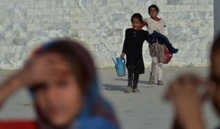 Afghan girls selling water at Nadir Khan hilltop in Kabul