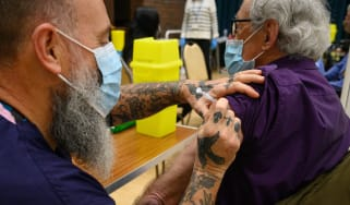 A paramedic gives a Covid-19 vaccination.