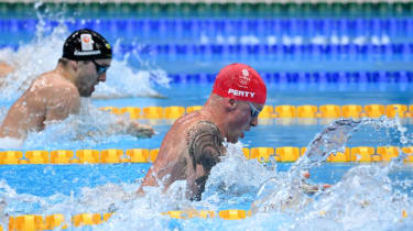 Adam Peaty defended his Olympic 100m breaststroke title