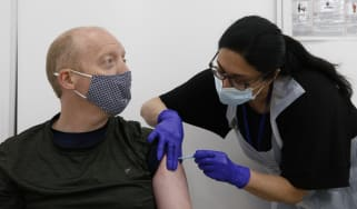 A man receives his Covid-19 vaccination