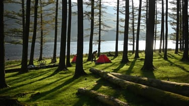 Campers wake as the sun rises over Buttermere Lake in the Lake District