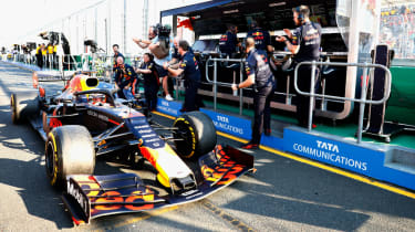 Red Bull staff celebrate Max Verstappen's third place at the 2019 F1 Australian Grand Prix