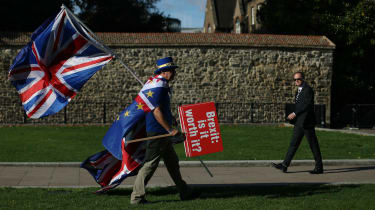 An anti-Brexit campaigner walks outside the Houses of Parliament