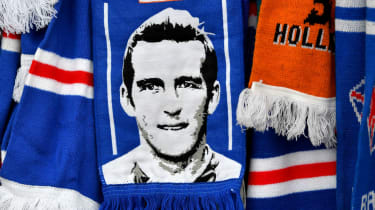 Rangers fans pay tribute to Fernando Ricksen by leaving scarves and flowers at the gates of Ibrox Stadium