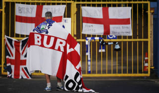 A Bury FC supporter outside the club's Gigg Lane ground