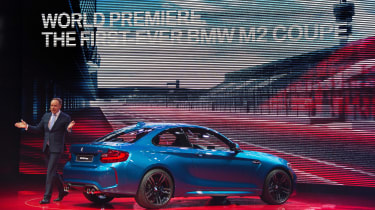 BMW's director for sales and marketing Dr. Ian Robertson (L) unveils the 2016 BMW M2 Coupe during the BMW press conference at the North American International Auto Show in Detroit, Michigan,