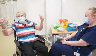 A patient celebrates getting his Covid vaccine at Southmead Hospital in Bristol