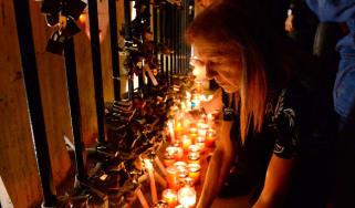 Locals hold a candlelight vigil for slain journalist Daphne Caruana Galizia