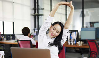 bigstock-asian-business-woman-stretchin_16x9.jpg