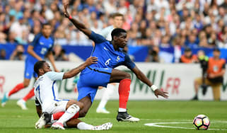 Paul Pogba of France battles with England's Raheem Sterling in Paris