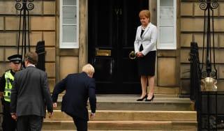 Nicola Sturgeon welcomes Boris Johnson outside Bute House