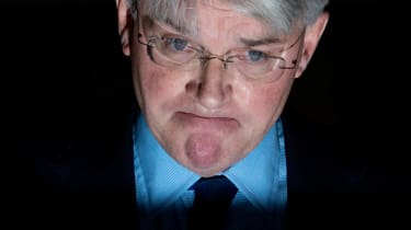 """Former cabinet minister and Conservative MP Andrew Mitchell talks to the media after he lost his libel action over the """"Plebgate"""" affair outside the High Court in London on November 27, 2014."""