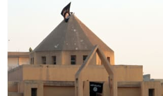 The flag of IS flutters on the 'dome' of a Syrian Christian Church