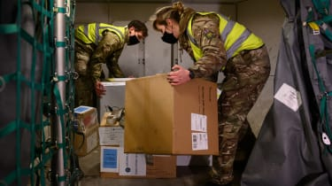 RAF personnel load a batch of the Covid-19 vaccine onto an aircraft
