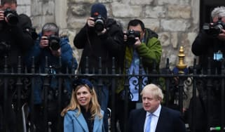 Boris Johnson and his fiancee Carrie Symonds leave the Commonwealth Day Service
