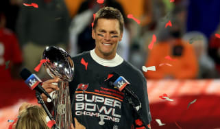 Tampa Bay Buccaneers quarterback Tom Brady lifts the Vince Lombardi Trophy after winning Super Bowl LV