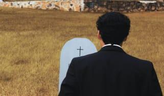 Man at gravestone