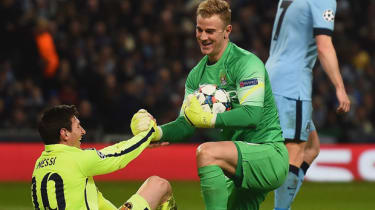 Joe Hart of Manchester City and Lionel Messi of Barcelona