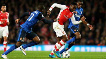 Danny Welbeck of Arsenal is tackled by Monaco players