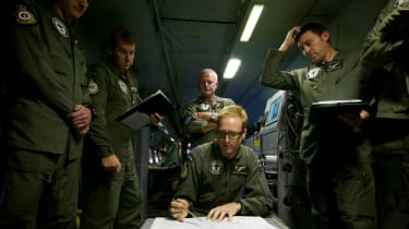 Search crews seek any sign of flight MH370