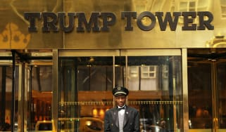 A doorman stands in front of Trump Tower on New York's Fifth Avenue