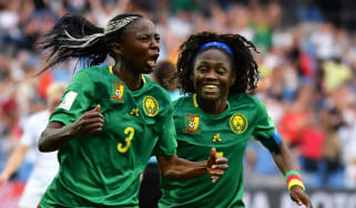 Ajara Nchout (left) celebrates her winner against New Zealand with Cameroon team-mate Gabrielle Onguene