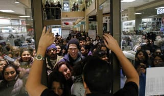 NEWPORT, NJ - NOVEMBER 27: People waits in line to go shopping at the to JCPenney store at the Newport Mall on November 27, 2014 in Jersey City, New Jersey. Black Friday sales, which now begi