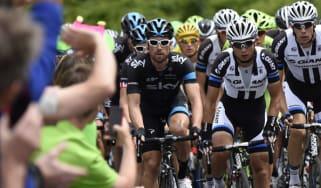 Cyclists pass spectators during the Tour de France