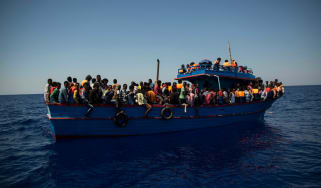 Migrants wait to be rescued by the Aquarius NGO rescue ship in the Mediterranean Sea